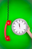 Red telephone and clock Royalty Free Stock Image