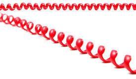 Red telephone cord. Retro red telephone cord on white Stock Photos