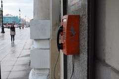 Red telephone. Old telephone in the heart of St. Petersburg. Back in the USSR stock photos
