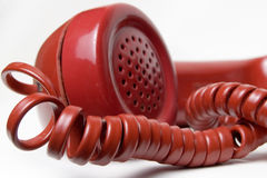 Red telephone receiver Royalty Free Stock Image