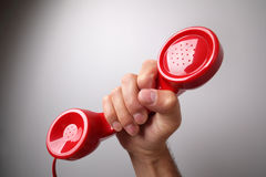 Red telephone receiver stock photography