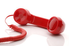 Red telephone receiver. Red old fashioned telephone handset  on a white concept for urgent or important customer support call Stock Photos