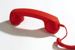 Red telephone receiver on white background Royalty Free Stock Image