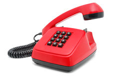 Red telephone set. Red phone with black buttons on a white background Stock Images