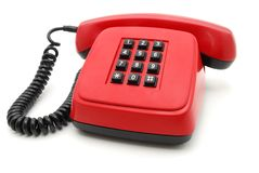 Red telephone set. Red phone with black buttons on a white background Royalty Free Stock Image