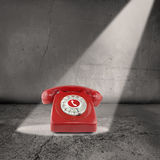 Red telephone in the spotlight Stock Photography