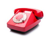 Red telephone on white Stock Photography