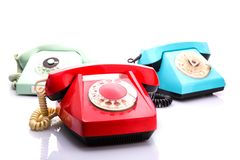 Red telephones on white Stock Photo