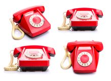 Red telephones on white Royalty Free Stock Photography