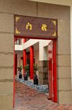 Red temple door and bonsai plants Stock Photo