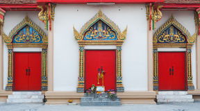 3 red temple doors. There are 3 red temple doors decorated with handicrafted traditional Thai art, Wat Moon Jindaram, Pathumthani, Thailand stock photos