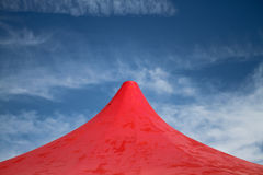 Red tent in blue sky Stock Image