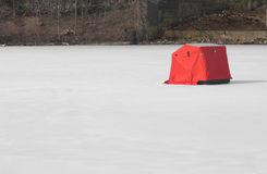 Ice fishing tent on frozen lake Stock Photo
