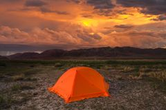 Red tent in the mountains on a sunset background Stock Photography