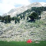 Red tent, pine trees and rocks. Valley near Tahtali Dagi, Turkey. Aged photo. Royalty Free Stock Photography