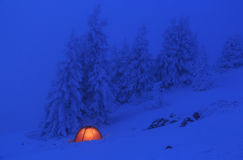 Red tent. In the snow of the Vercors mountains in France stock photography