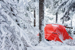 Red tent in winter forest. Tourist camp in snowy .  in the snow in Stock Images