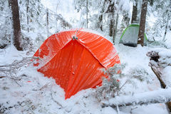 Red tent in winter forest. Tourist camp in snowy . in the snow in Royalty Free Stock Image