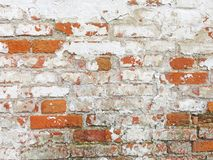 Red, Terracotta and White Brick Background. Old Wall of Red Bricks and White Brayed and Cracked Old Paint. stock photos