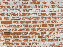 Red, Terracotta and White Brick Background. Old Wall of Red Bricks and White Brayed and Cracked Old Paint. stock image