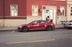 Red Tesla model S, full-size all-electric five-door Royalty Free Stock Images