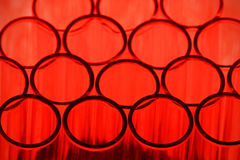 Red Test Tube Background. Close up of test tubes against a red background. Shallow d o f Royalty Free Stock Images