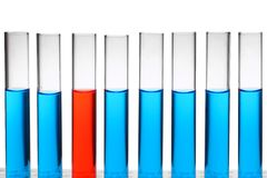 Red test-tube among blue ones Stock Photo