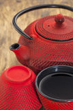 Red tetsubin with cups Royalty Free Stock Images