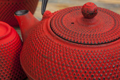 Red tetsubin with cups Royalty Free Stock Photography