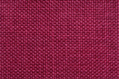 Red textile background with checkered pattern, closeup. Structure of the fabric macro. Stock Photos