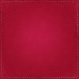 Red textile background with seams. Around Stock Photos