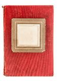 Red textile book cover with vintage photo frame Royalty Free Stock Photo