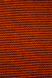 Red textile fabric. Close-up texture pattern background Royalty Free Stock Images