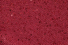 Red textile fabric with sequins as background Royalty Free Stock Images