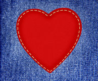 Red textile heart on fabric jeans in grunge style Stock Photo