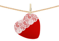 Red textile heart with lace hang on clothespin isolated on white Royalty Free Stock Photos