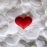 Red textile heart on white hearts background stock image