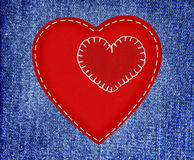 Red textile hearts on fabric jeans in grunge style Royalty Free Stock Photo