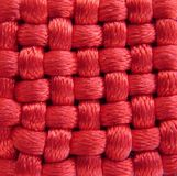 Red textile pattern texture. Red textile texture fiber from lucky Chinese amulet Royalty Free Stock Images