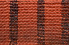 Red roof tile texture. Red texture of roof with three darker vertical stripes Stock Photos