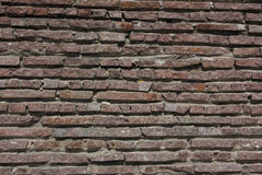 Red texture from stone masonry Stock Photography