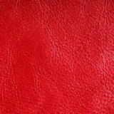 Red textured leather grunge background closeup Stock Photo