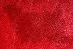 Red textured leather grunge background closeup Stock Image