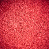 Red textured leather skin grunge background closeup Stock Photos