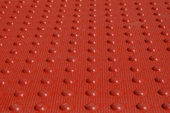 Red Textured Mat. Red bumps from a rubber mat up close Stock Photography