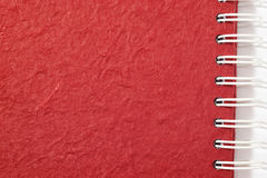 Red textured notebook Stock Photography