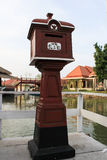 Red thai mail box. In a city Stock Photography