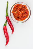 Red Thai peppers and sauce Royalty Free Stock Images