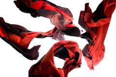 Red Thai Silk in Mid-Air. Beautiful thai silk shot in mid-air in studio Royalty Free Stock Photos