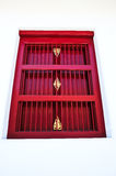 Red thai style window. On white wall Stock Photo
